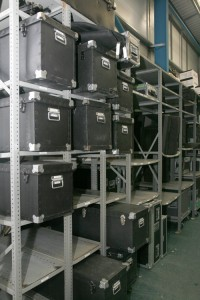 A metal rack of boxes in a warehouse